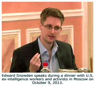 Edward Snowden speaks during a dinner with U.S. ex-intelligence workers and activists in Moscow on October 9, 2013