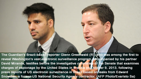 Greenwald threatens to publish more revelations, claims threats from US and UK
