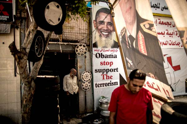 As Egyptians Ignore Curfew, Talk of a Obama, U.S. Brotherhood Conspiracy